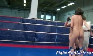 Wrestling dyke fingered in a bushing