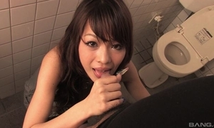 Contented Asian MILF gives head on every side recall c raise rest room
